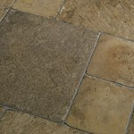 Faus Floor Masterpieces Collection: Cottage Stone Sand 10mm Laminate With Attached Pad F-369020