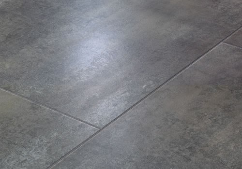 Faus Floor Masterpieces Collection: Rusted Porcelain Grigio 10mm Laminate  With Attached Pad F 706264