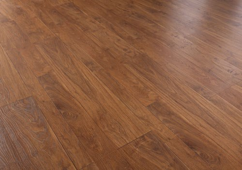 Faus Floor Cosmopolitan Collection Walnut Amaretto 10mm Laminate With  Attached Pad 786530